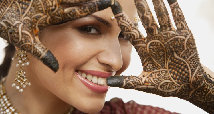 Woman with ornate henna design on hands