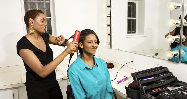 Woman styling another woman's hair