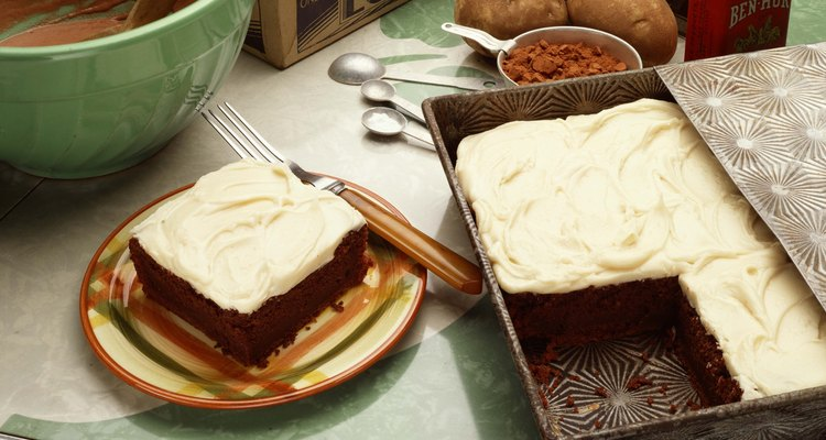 Add small amounts of thickeners to cream cheese frosting to avoid making it too dense.