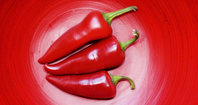 Close-up of three red chili peppers
