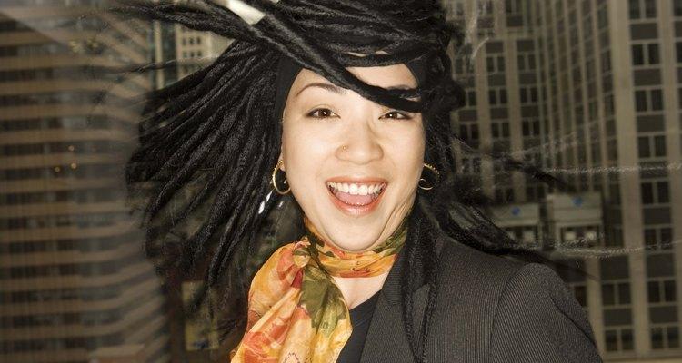 Urban woman twirling dreadlocks
