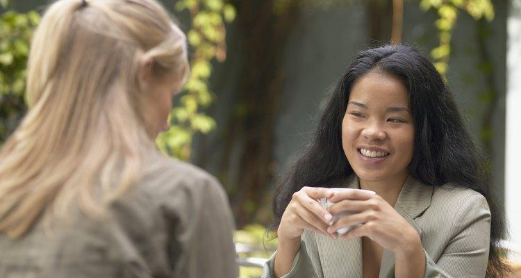 Asian woman talking to friend