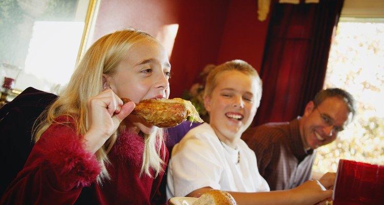 Girl devours turkey leg