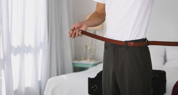 Man putting on belt