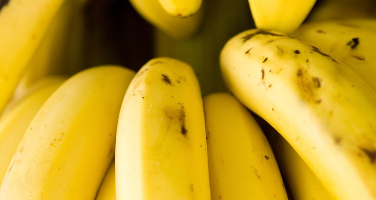 Decorate a cake with bananas for an attractive finishing touch.