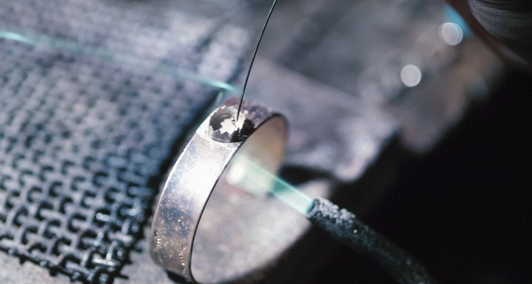 A torch used for soldering is an important tool that's part of a jeweller's work bench.