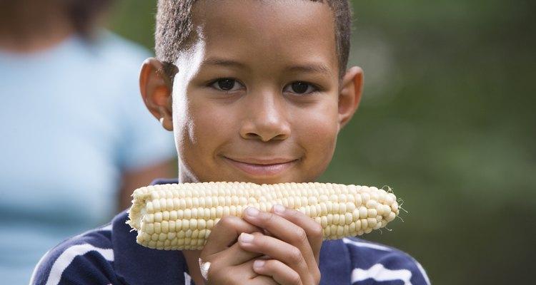 Boy holding ear of corn