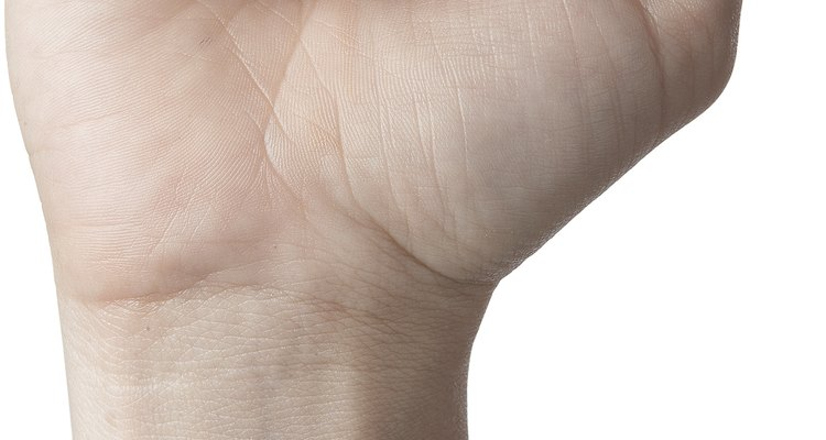 Crack your knuckles loudly by first making a fist.