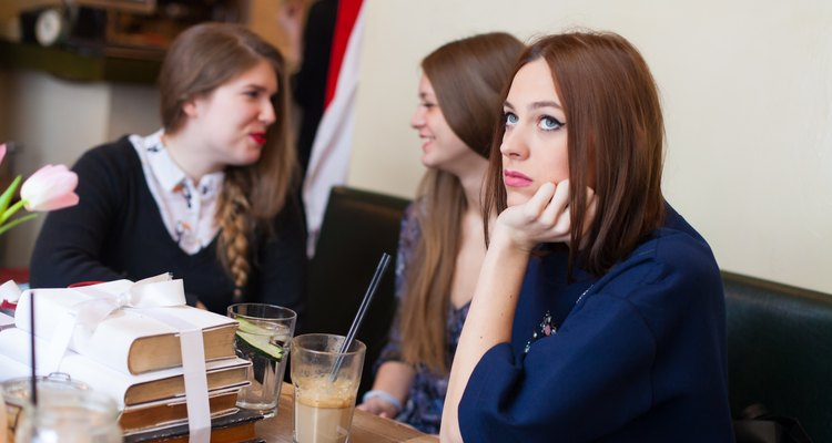 concerned young woman in coffee shop
