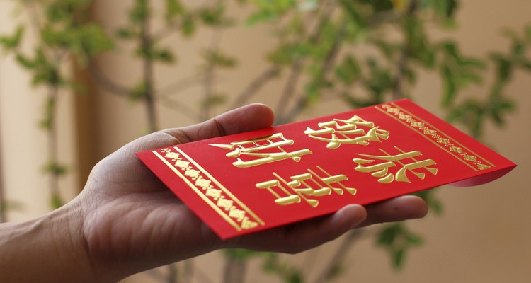 Chinese red pocket on hand.