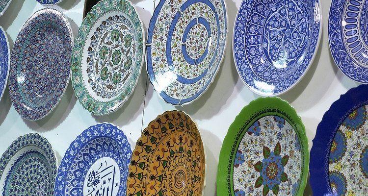 Decorative plates hanging in a symmetrical pattern on a wall can add to your decor.