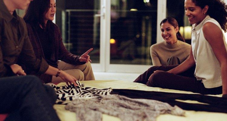 Women Friends Sitting Around Apartment Talking