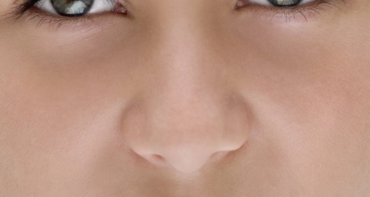 Close-up of young girl's face, part of