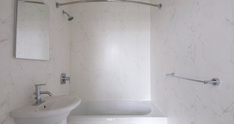 Prevent pink mould with weekly shower washings.