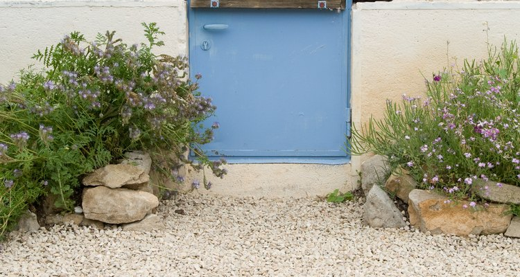 Improve your outdoor space by making a gravel pathway or patio.