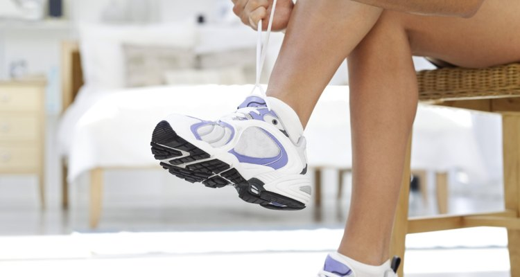 low angle view of woman tying the laces on her sneakers