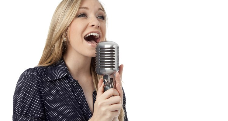 Woman Sings into a Vintage Microphone