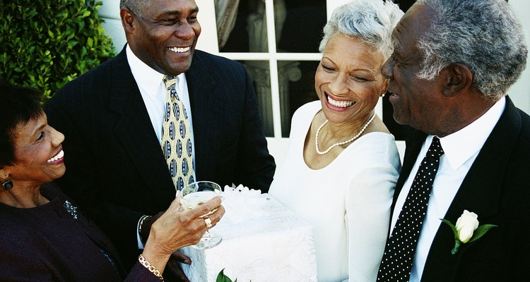 Four Mature Adults Standing Outside a Building at a Wedding Reception