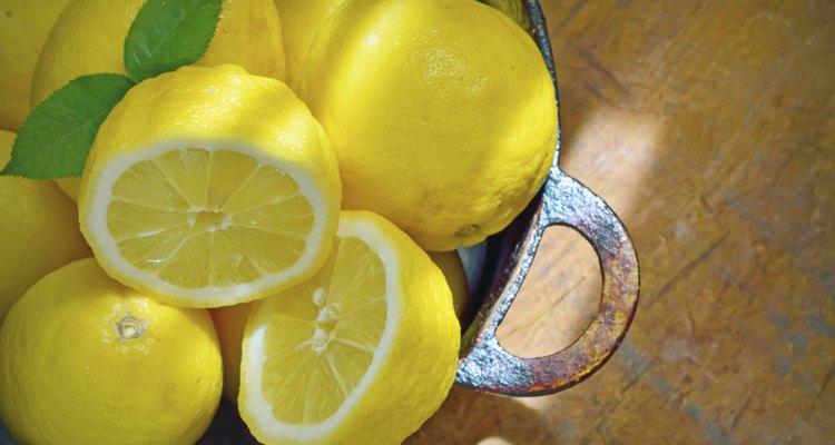 fresh lemons on a wood table