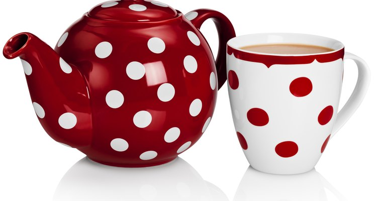 Set out tea pots and cups that feature fun designs.