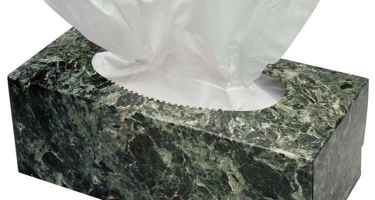Use lenços de papel para limpar as lentes