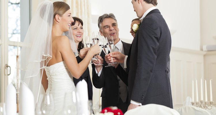Wedding party clinking glasses