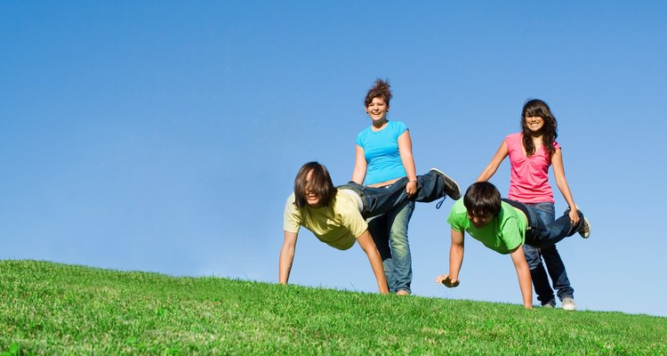 diverse  group of active teens playing outdoors