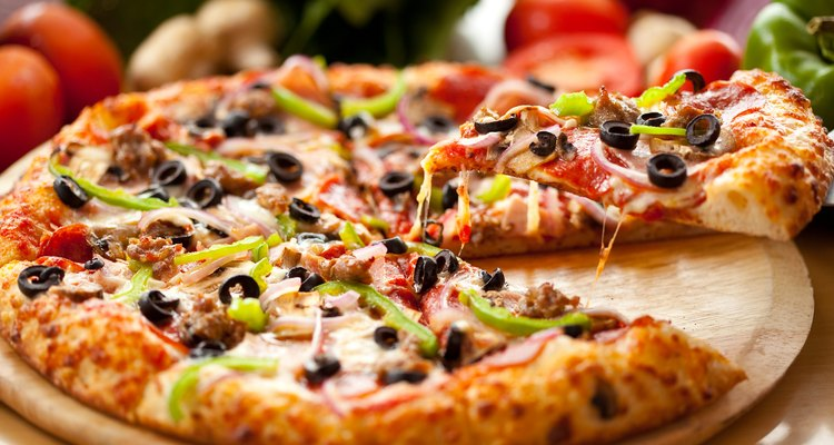 You can cook pizza on certain types of George Foreman grill.