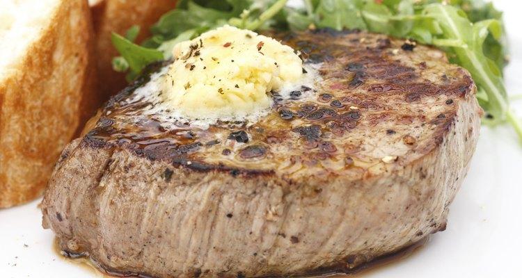 Perfect roast pork tenderloin fillet steak topped with melting butter.