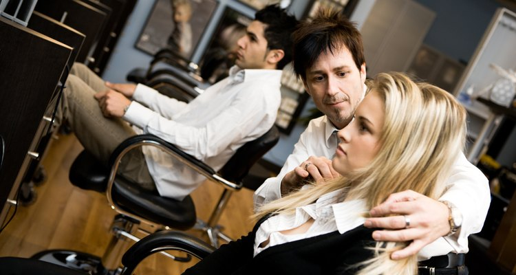Hair stylist with client in beauty salon