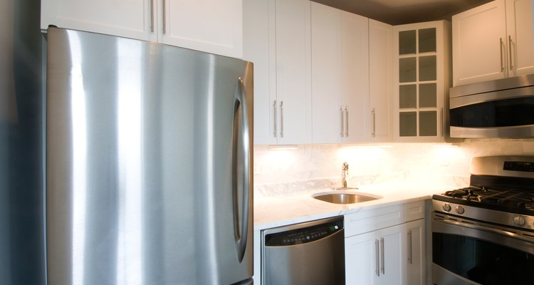 There are several ways to keep a refrigerator door from striking and damaging walls.