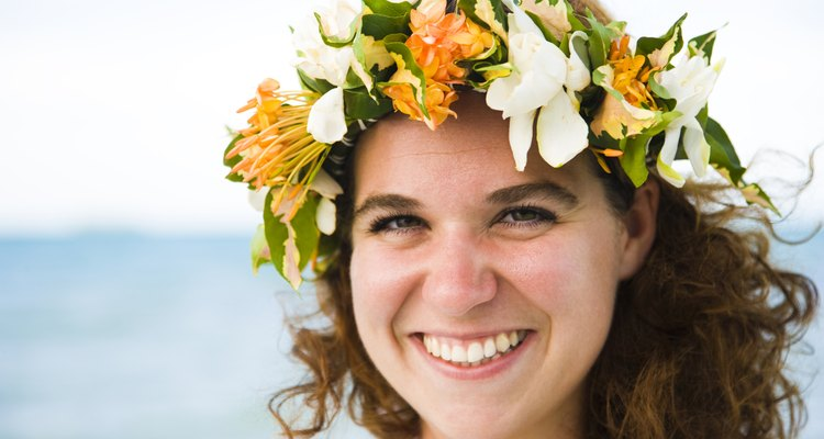 Portrait of a woman wearing a wreath of flowers and smiling, Tahaa, Tahiti, French Polynesia