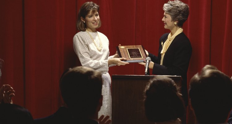 When presenting an award make sure your right hand is free to shake with the recipient.
