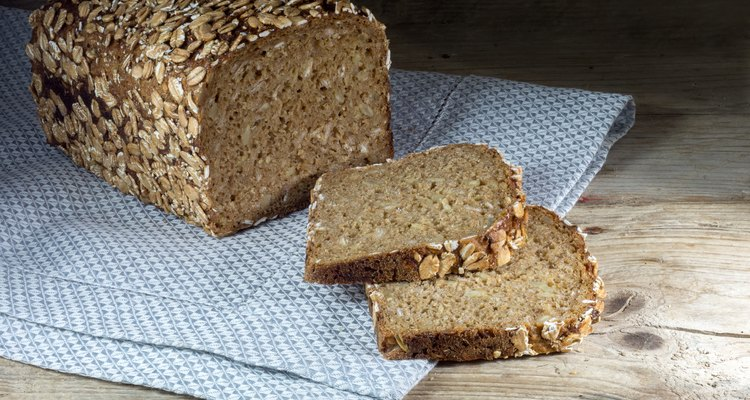 rye bread with whole grain on a napkin and wood