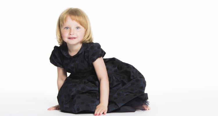 blonde 5 year old girl kneeling