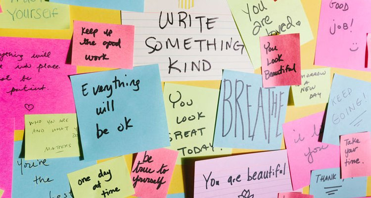 wall covered in notes with positive sayings