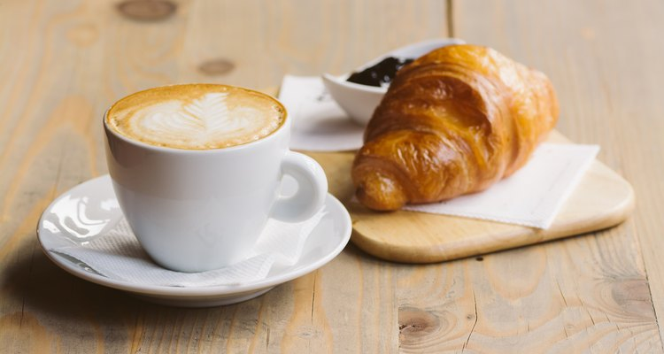 Coffee and Croissant on a wooden table