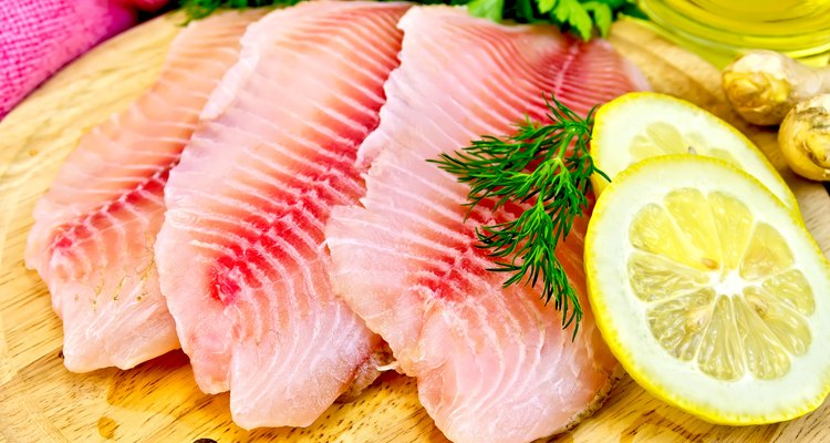 Fresh tilapia fillets with oil and lemon