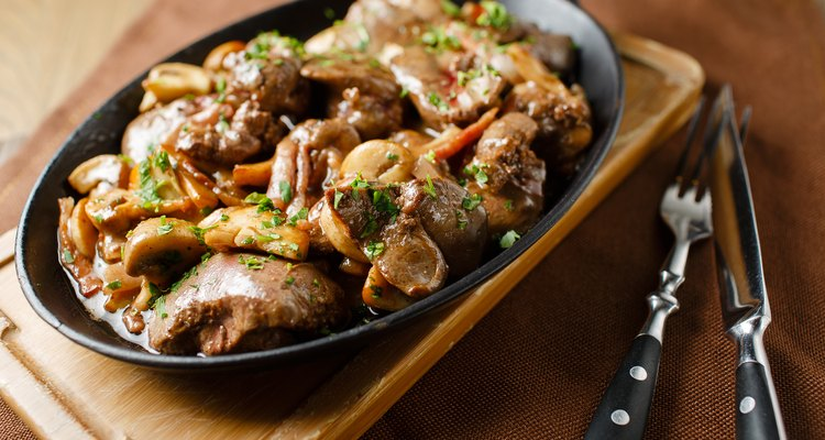 Liver baked with mushrooms, bacon and herbs