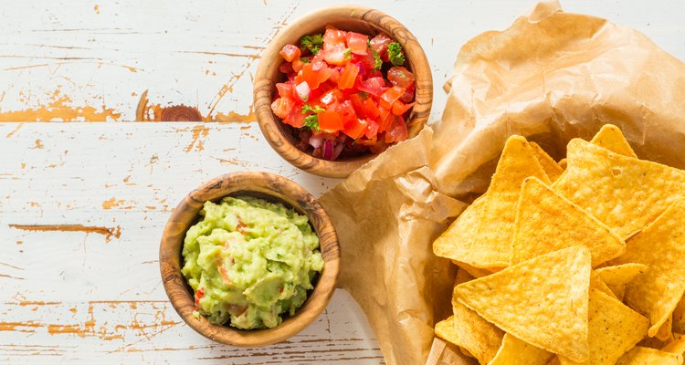 Homemade tortilla chips with salsa and guacamole