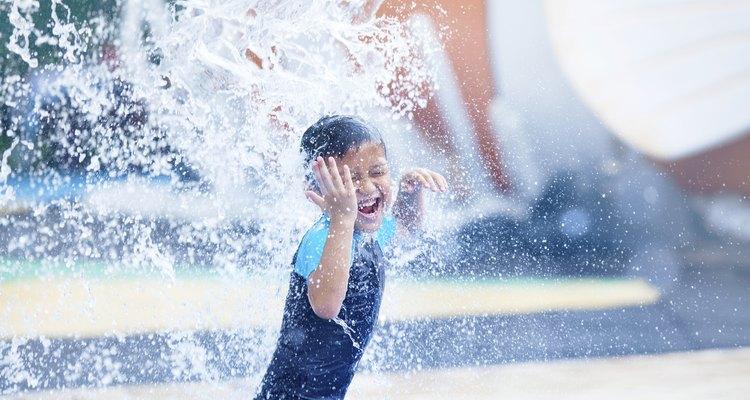 Little boy having fun at splash pad