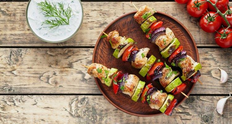 Grilled turkey or chicken meat shish kebab skewers with tzatziki