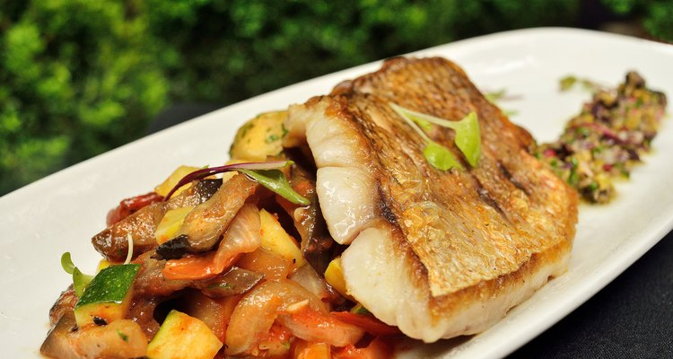 Chilean Sea Bass with potatoes and vegetables on the patio