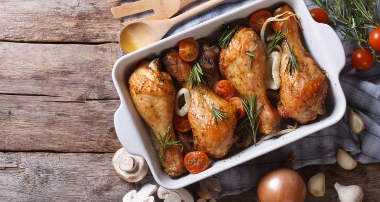 Baked chicken legs with mushrooms and vegetables. horizontal top