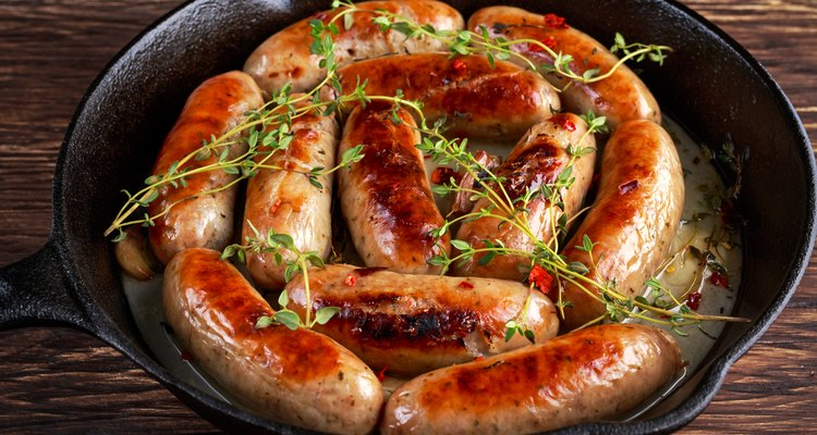 Home-made Pork Sausages in rustic pan with thyme