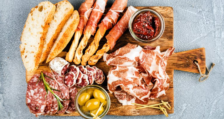 Meat appetizer selection or wine snack set. Variety of smoked