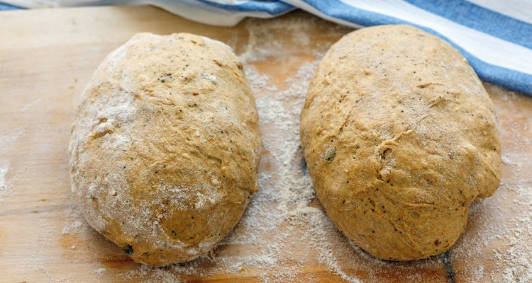 Preparing dough for baking homemade pumpkin bread.