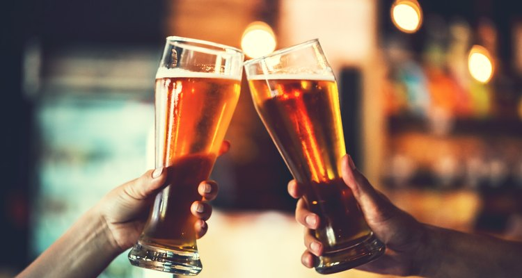 Two friends with glasses of beer. Shallow DOF
