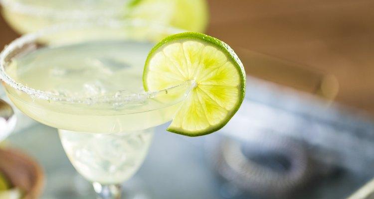 Key lime margarita garnished with fresh lime