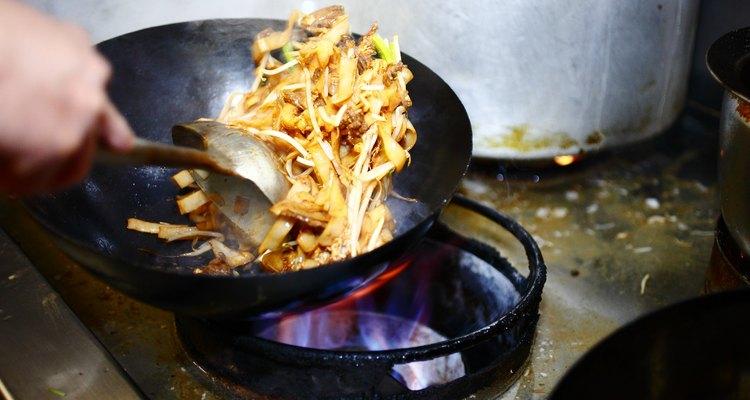 Preparing food in restaurant kitchen